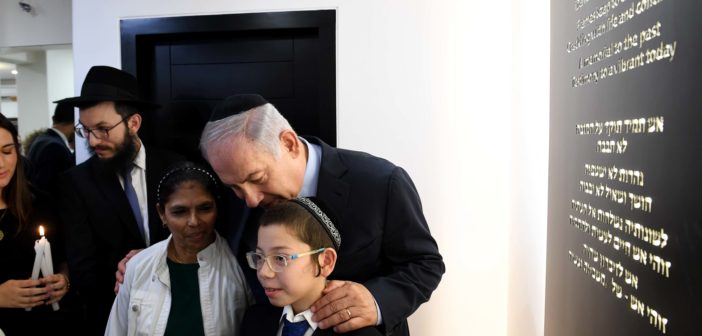 Israeli PM Netanyahu at Mumbai's Chabad House with Moshe Holtzberg who lost his parents in the 2008 terror attack