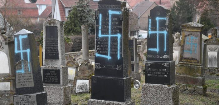 Desecration of a Jewish cemetery in France: French President Macron promises acts to fight antisemitism as he visits the scene